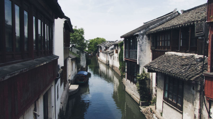 Architecture Building Exterior Built Structure Canal Day House Narrow No People Outdoors Residential Structure Sky Surrounding Town Water Waterfront