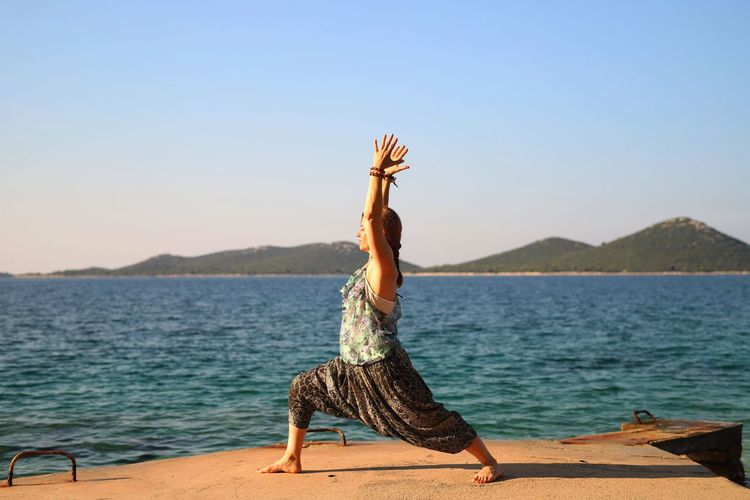Yoga Pose Yogagirl Yoga Practice Croatia Adriatic Sea Mountain View One Person Water Sky Leisure Activity Real People Lifestyles Nature Women Tranquility Beauty In Nature Human Arm Full Length Sea Clear Sky Young Adult Day Sunlight Scenics - Nature Outdoors Arms Raised Hairstyle