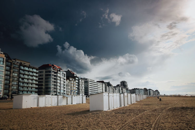 Low angle view of buildings on beach against sky