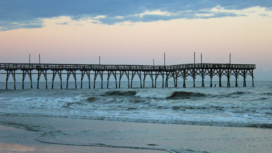 Sunset Beach Pier Beach Beauty In Nature Fishing Boat Ocean View Outdoors Scenics Sea Sunset Vacation Wooded Structure