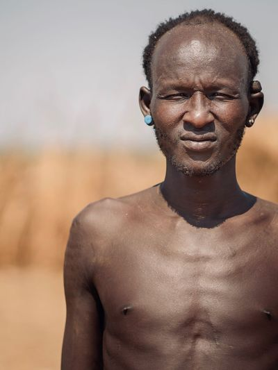 Dassanech Tribe Village near Omorate Dassanech Tribe Ethiopian Photography 🇪🇹 African Africa Ethiopian Portrait Photography Tribes Tribe Tribal Omo Valley Portrait One Person Front View Portrait Lifestyles Shirtless Focus On Foreground Young Men Headshot Real People Adult Leisure Activity Day Men Young Adult Males  Looking At Camera Land Outdoors Mature Men