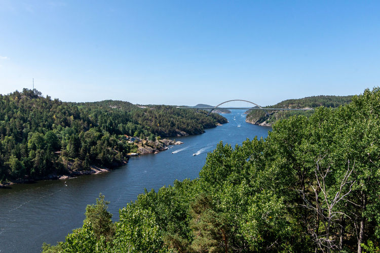 Country Border Norway Sweden Beauty In Nature Blue Bridge Clear Sky Connection Day Forest Green Color Growth High Angle View Nature No People Outdoors Plant River Scenics - Nature Sky Svinesund Tranquil Scene Tranquility Tree Water