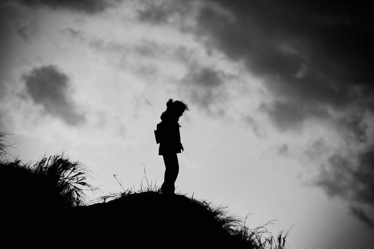 Side View Of A Silhouette Man Against Sky
