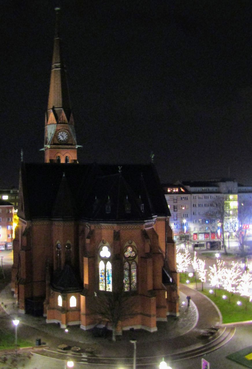 ILLUMINATED BUILDINGS AGAINST SKY AT NIGHT