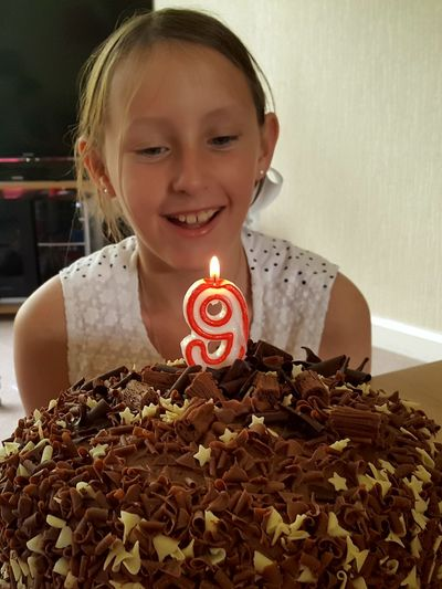 Smiling Girl Celebrating Birthday At Home