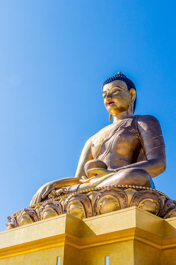 ASIA Buddhist Clear Sky Gold Thimphu Architecture Bhutan Blue Sky Buddha Statue Buddhism Human Representation Low Angle View No People Religion Spirituality Statue