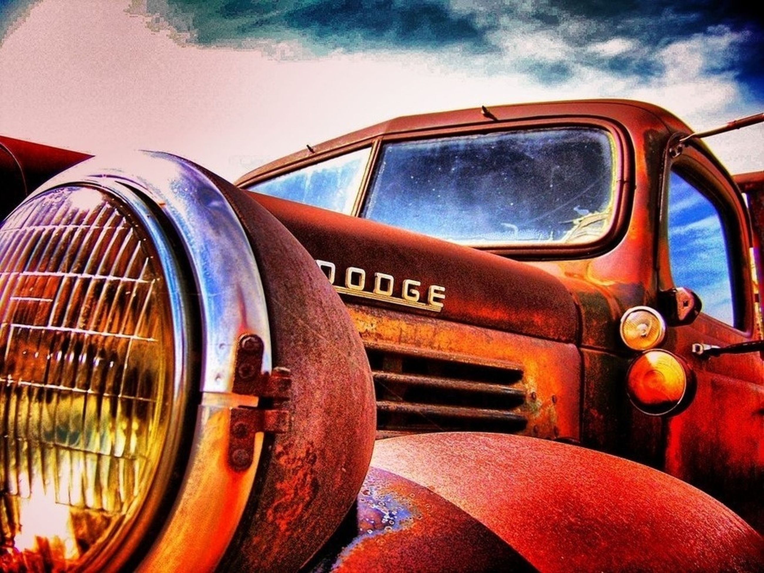 transportation, mode of transport, land vehicle, sky, car, close-up, cloud - sky, part of, old-fashioned, wheel, travel, stationary, old, vehicle part, rusty, metal, train - vehicle, vehicle interior, side-view mirror, vintage car