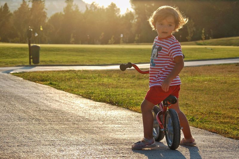 A little biker backlight Backlight Biker Child Full Length Childhood One Person Sunlight Casual Clothing Baby Cute Transportation Young Nature Lifestyles Real People Grass Babyhood Leisure Activity Innocence Plant Day