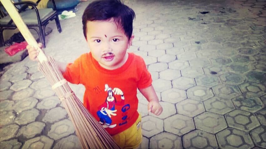 My Lovely Nephew  is ready to clean the house yard.. :D