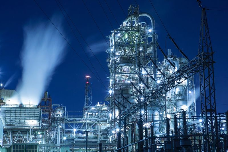 Illuminated Refinery Factory At Night