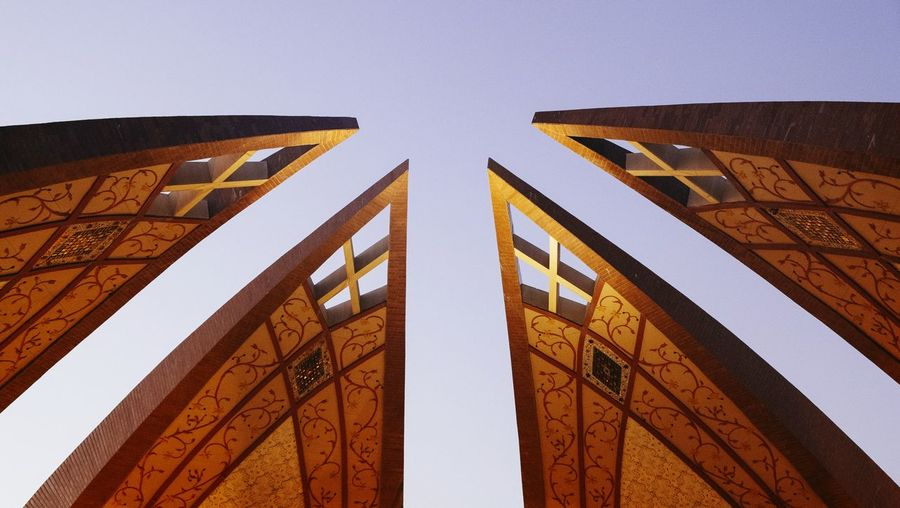 Low angle view of pakistan monument petals against clear sky