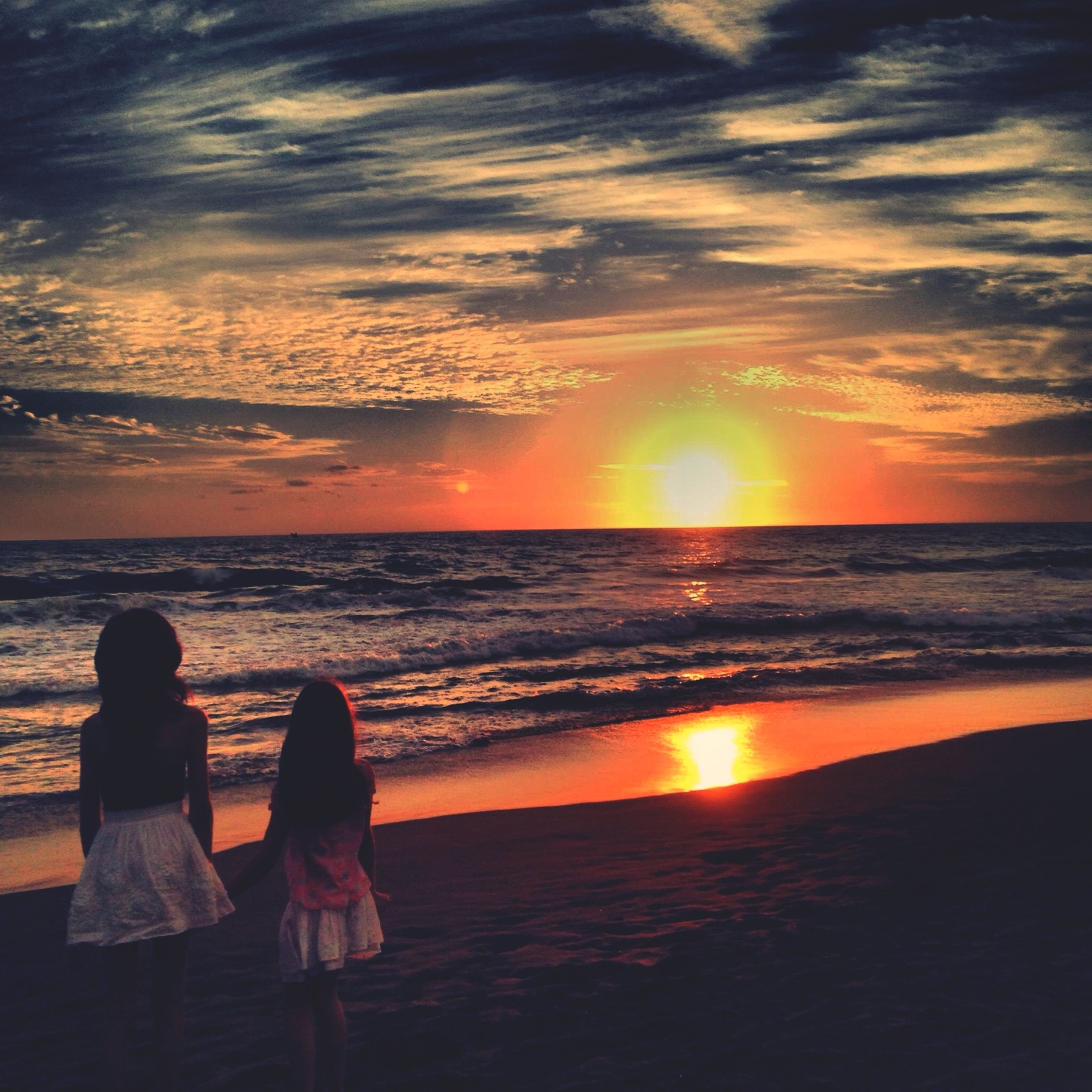 sunset, sea, horizon over water, water, beach, sky, scenics, sun, beauty in nature, lifestyles, leisure activity, tranquil scene, orange color, shore, tranquility, cloud - sky, idyllic, nature, person