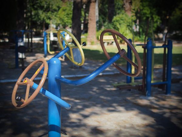 Another view of this contraption Metal Outdoors No People Focus On Foreground Park - Man Made Space Bicycle Rack Outdoor Play Equipment Day Childhood Tree Nature Close-up Shallow Depth Of Field Outside Gym Excercise