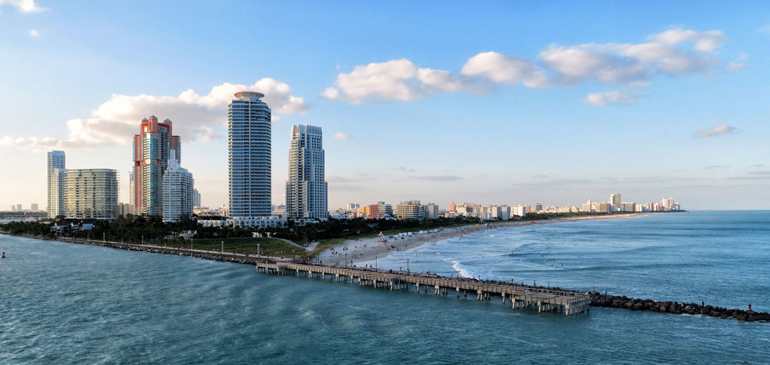 Goodbye Miami Architecture Sea Water Nature City Modern Sky Building Office Outdoors Tower Skyscraper Cityscape Waterfront Travel Photography Urban Skyline No People Cloud - Sky Building Exterior Tall - High Built Structure Office Building Exterior Capture Tomorrow 17.62°