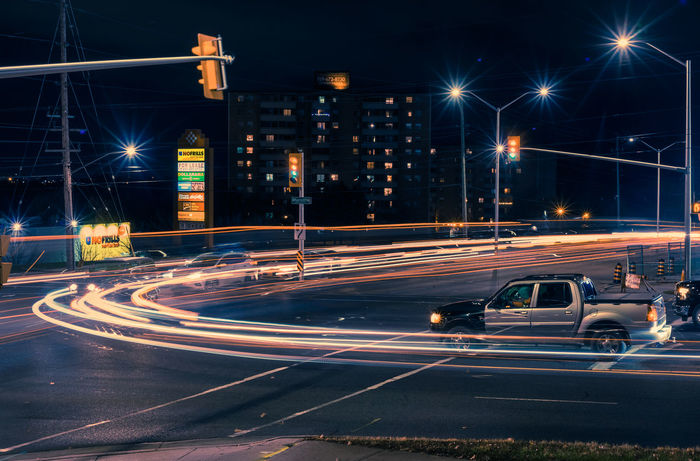 Long exposure photo of traffic lights in London, Ontario, Canada Mobility In Mega Cities Architecture Blurred Motion Building Exterior City City Life High Street Illuminated Light Trail Long Exposure Motion Night No People Outdoors Road Sky Speed Street Street Light Traffic Transportation Urban Scene