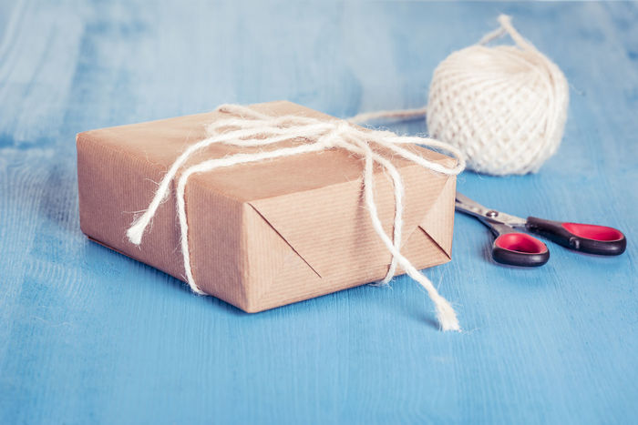 Paper wrapped gift - Homemade gift box wrapped with classic brown paper and tied with white string, scissors and twine in background Birthday Gift Holiday Gifting Scissors Selfmade Twine Wooden Table Homemade Gift Still Life White String Wrapped Gift Wrapping Paper