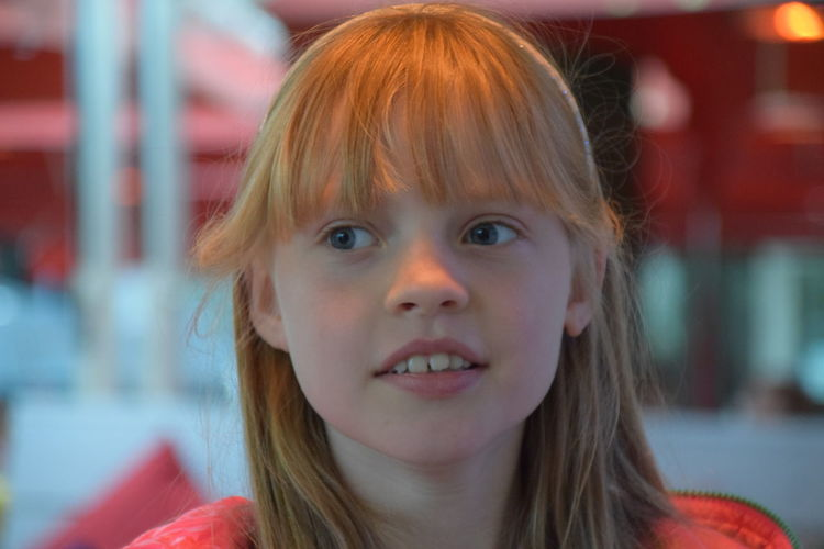 Close-Up Portrait Of Cute Little Girl