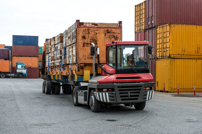 Mobile stacker handler in action at a container terminal. Harbor Architecture Building Exterior Built Structure Cargo Container Commercial Land Vehicle Day Export Freight Transportation Import Industry Land Vehicle Logistic Mode Of Transport No People Outdoors Sky Terminal Transfer Transportation
