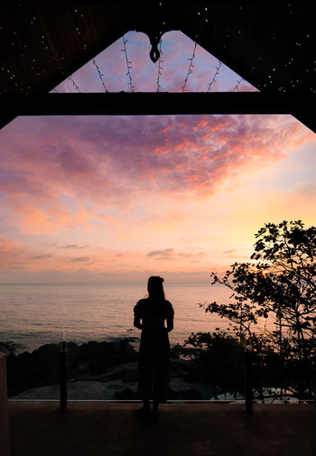 Sky One Person Real People Sunset Silhouette Beauty In Nature Cloud - Sky Leisure Activity Lifestyles Scenics - Nature Tree Standing Rear View Orange Color Nature Plant Photography Themes Men Horizon Over Water Outdoors Photographer Looking At View
