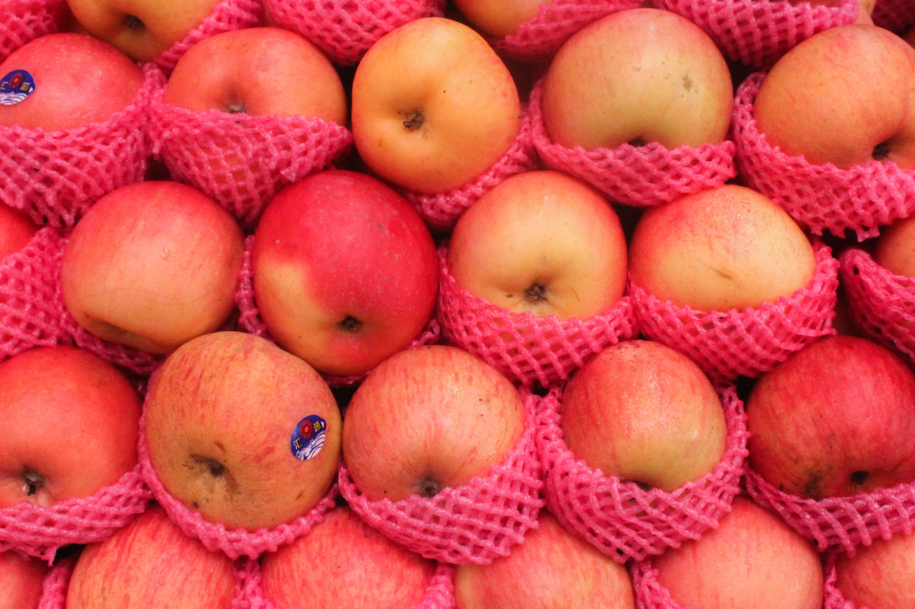 healthy eating, fruit, food and drink, food, wellbeing, freshness, large group of objects, full frame, abundance, backgrounds, no people, red, market, close-up, apple - fruit, retail, group of objects, high angle view, day, pink color, lychee, ripe, consumerism