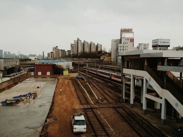 High Angle View Of Train Tracks Against Buildings