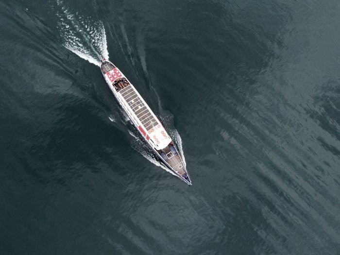 Drone photo of a ship at the lago maggiore in locarno, switzerland