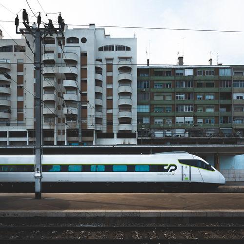 Train against buildings in city