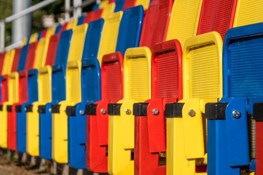 Stadium Stadium Seating Architecture Backgrounds Blue Choice Close-up Day Focus On Foreground Full Frame Hockey In A Row Multi Colored No People Order Outdoors Pattern Red Repetition Seat Seating Bench Side By Side Soccer Sport Sport Arena Variation Vibrant Color Yellow The Architect - 2018 EyeEm Awards Creative Space The Still Life Photographer - 2018 EyeEm Awards Summer Sports