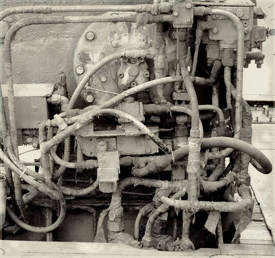 A vintage diesel engine used to power an aging fishing vessel Diesel Engine Fuel Hose Hoses Leaking Monochrome Motor Obsolete Technology Ship Engine Tubes Vintage