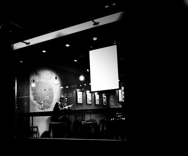 Man at illuminated music concert