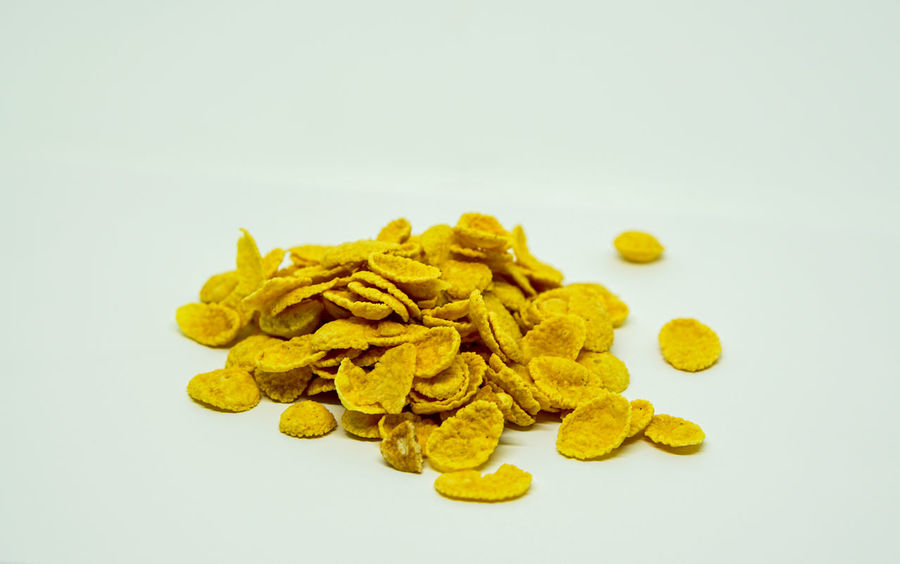 Capsule Close-up Food Healthcare And Medicine Healthy Eating Heap Ingredient Large Group Of Objects Medicine No People Nutritional Supplement Potato Chip Stack Studio Shot Vitamin White Background Yellow