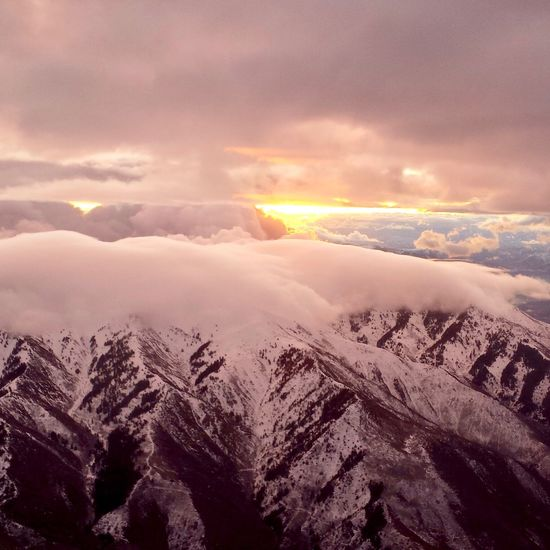 Sunrise over the Wasatch Range from the air. My Point Of View Travel Beautiful Day Beauty In Nature Winter Weather Magnificent Magestic The Week on EyeEm Aerial Shot Aerial View Mountain Range Sunrise And Clouds Sunrise Sunrise Photography Backgrounds Background Background Photography Wasatch Mountains Beauty In Nature Nature Cloud - Sky Sky Scenics Tranquility Tranquil Scene Cold Temperature Weather Snow Mountain
