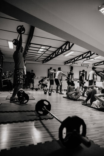 Crossfit workout group training indoors. Cross fitness motivation. Black and white Real People Lifestyles Indoors  Gym Fitness Fitness Training Crossfit Crossfitmotivation Gymnastics Motivation Sport Group Of People Group Training Training Sweat Stretching Power Step Intensive Weights Weight Training  Warm Up Fitness Time Monochrome Blackandwhite