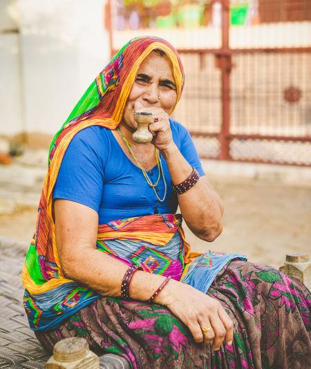 Portrait Of Woman Smoking Pipe Cigarette