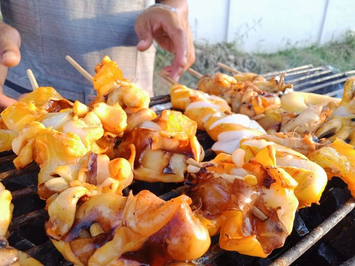 Close-up of preparing food on barbecue grill