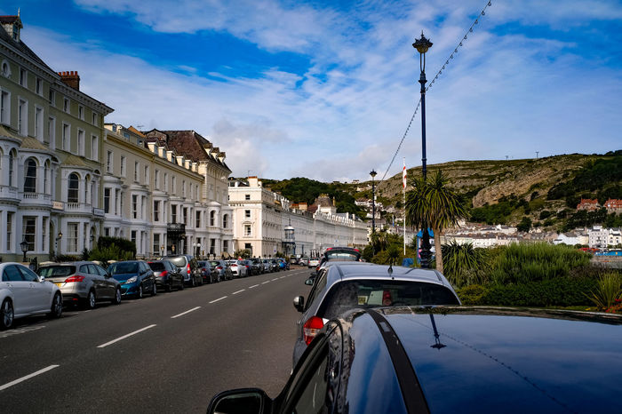 Llandudno, North Wales, on the Creuddyn peninsula. Creuddyn Peninsula Architecture Building Exterior Built Structure Car Car Parking Cloud - Sky Day Great Orme Hotel Land Vehicle Llandudno Mode Of Transport Nature No People North Wales Outdoors Parked Vehicle Road Sky Street Lighting Transportation Tree