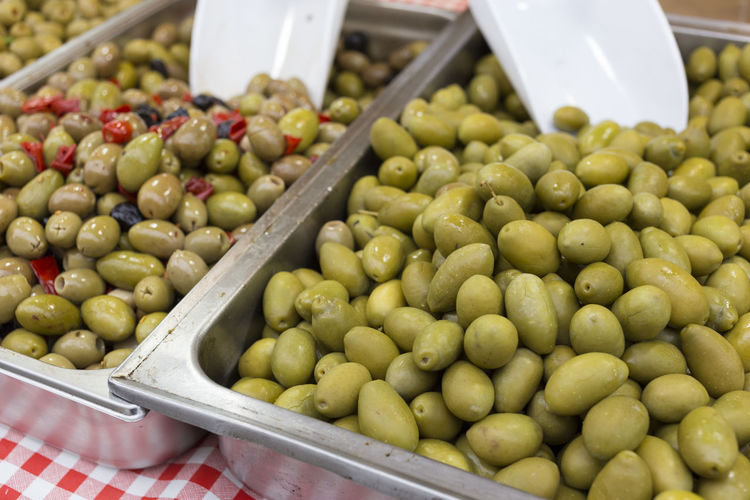 Close-up of olives for sale in market
