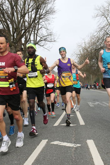 Happy Runner Athlete Brighton Marathon Competition Competitive Sport Day Effort Group Of People Healthy Lifestyle Lifestyles Marathon Men Motion Outdoors Pacer People Real People Road Running Smile Sport Sports Clothing Sports Race Transportation Vitality
