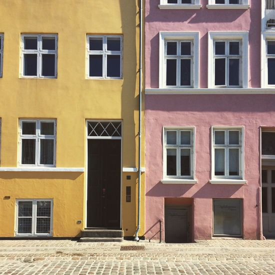 Yellow Vs Pink ! What's your favorite ? 😁 ❤ Enjoying The Sun Colours Colour Pink Yellow Wall Bulding House Houses Dwelling Window Windows Copenhagen Danmark Beautiful City Street Cityscapes Streetphoto_color Minimalism Denmark Architecture Picoftheday City Life