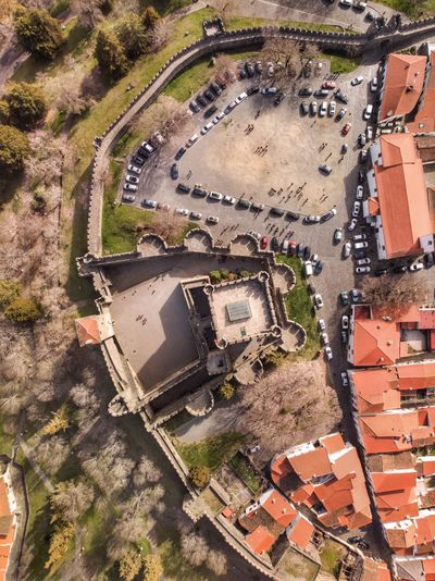 Top down view from Bragança's castle DJI X Eyeem DJI Mavic Air Drone Photograph High Angle View Day Architecture Built Structure Building Exterior Nature No People Land Residential District Car Motor Vehicle Plant Transportation Building Full Frame Sunlight Water Outdoors City Field