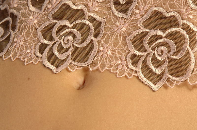 Close-Up Of Netting On Woman Stomach