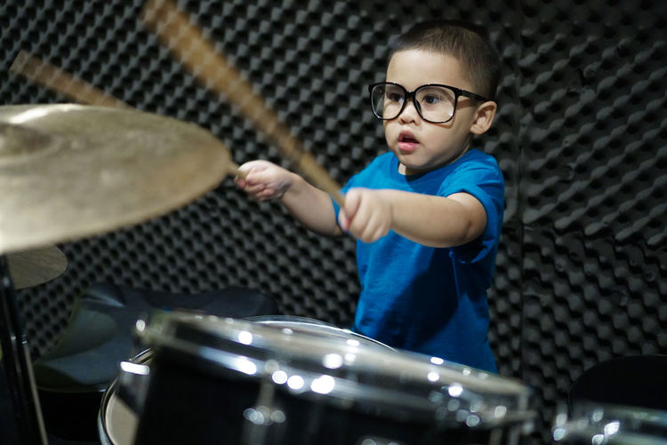 Drum Drummer Learning Play Music Rock Student Students Teaching Boys Child Drumming Drumming Class Front View Glasses Music Class Music School One Person
