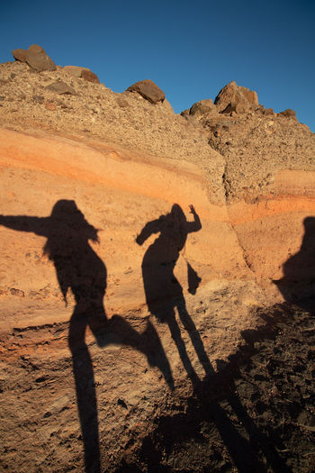 Shadow of women on rock formation