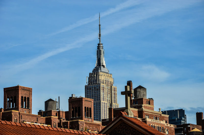 Church Against Empire State Building Amidst Towers In City