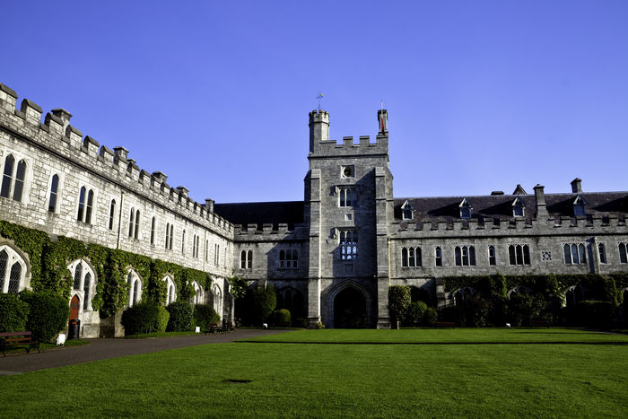 Arch Architectural Column Architecture Blue Building Exterior Built Structure Clear Sky Day Exterior Façade Famous Place Grass Green Color History Ireland Lawn No People Outdoors Quad Quadrangle Sky Tourism Travel Destinations UCC University