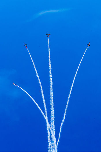 Aerobatics Aerospace Industry Air Vehicle Airplane Airshow Blue Cloud - Sky Cooperation Flying Low Angle View Mid-air Mode Of Transportation Motion Nature No People on the move Outdoors Plane Sky Smoke - Physical Structure Speed Teamwork Trail Transportation Vapor Trail