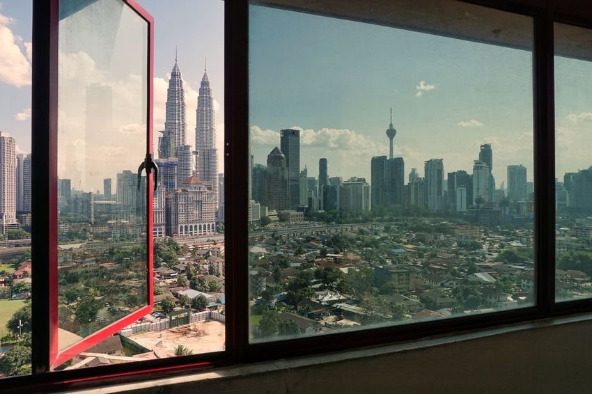 Kuala Lumpur skyline, view from window. Frame Framing Skyscraper Cityscape City Window Architecture Urban Skyline Business Finance And Industry Building Exterior Looking Through Window Built Structure Downtown District Reflection Travel Destinations Modern Indoors  Sky Apartment Business Day Transparent Glass - Material Tower Growth Tall Nature