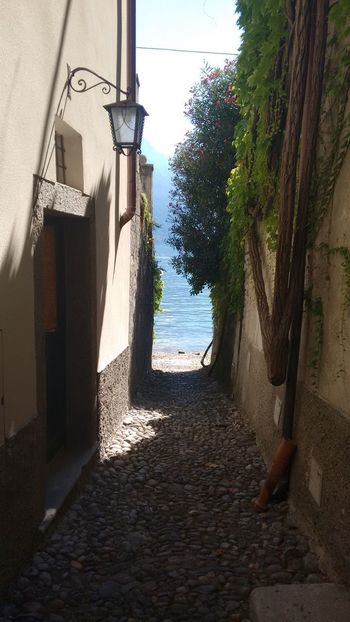 Discovering Lonely Architecture Beach Bellagio Building Exterior Built Structure Day Horizon Over Water House Italy Lake Nature No People Outdoors Sand Sea Sky Small Street Small Village Summer Feeling The Way Forward Tree Water