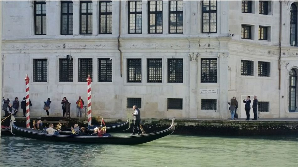 Architecture Water Shadow Day Gondola Travel Destinations Arts Culture And Entertainment Italy Venezia EyeEmbestshots Venice Carnival Architecture Simmetry Daylight Outdoors Art Lights Colors Venice City Travel EyeEmNewHere EyeEmBestPics Let's Go. Together. Your Ticket To Europe