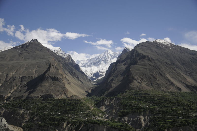 The beautiful view of Karimabad Hunza Valley at Pakistan Hunza Valley Pakistan Pakistan Beauty Blue Sky Day Getty Creative Gettyimages Karimabad Landscape Mountain Mountain Peak Mountain Range Mountains And Sky Nature No People Outdoors Sky Snow Montai Travel Destinations Valley